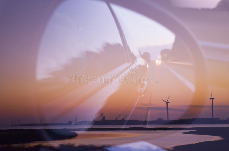 Double exposure of beautiful landscape and car mirror. Soft focus royalty free stock photos