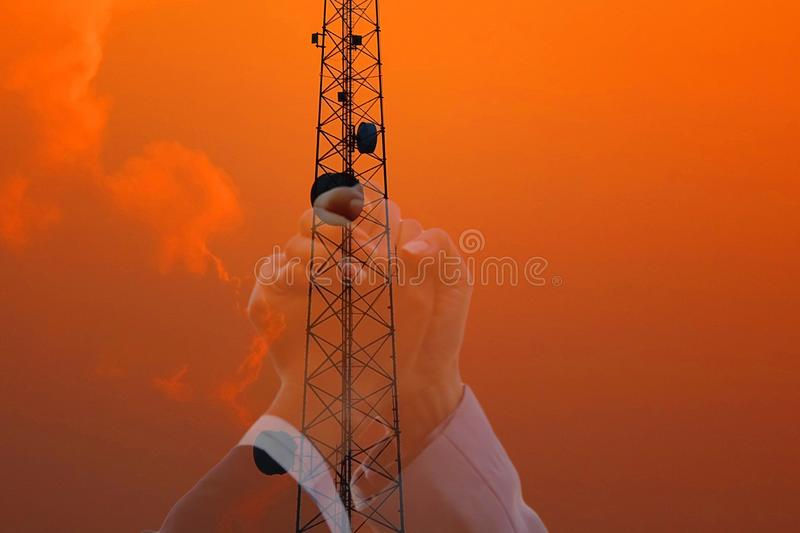 Double exposure  of beautiful sky after sun set with telecommunication pole and woman hand in hand  join in telacommunication royalty free stock photos