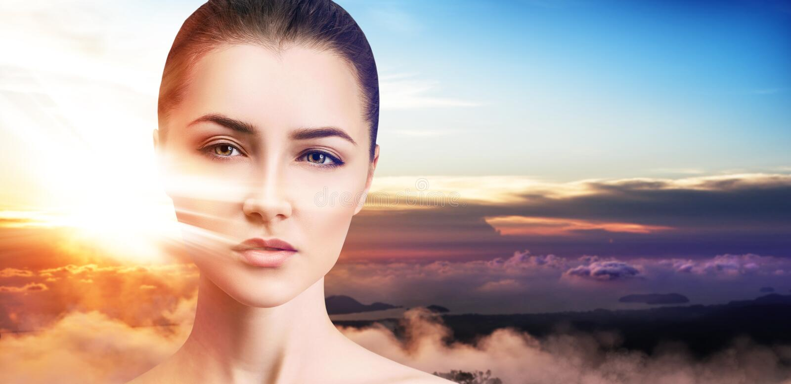 Double exposure of beautiful woman face and sunset. royalty free stock images