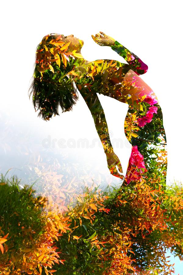 Double exposure of an elegant girl leaning back combined with photograph of bright tropical plants with vibrant flowers stock image