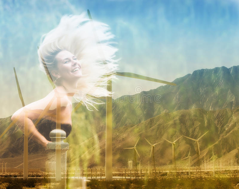 Double exposure of blond woman and wind turbine royalty free stock photo