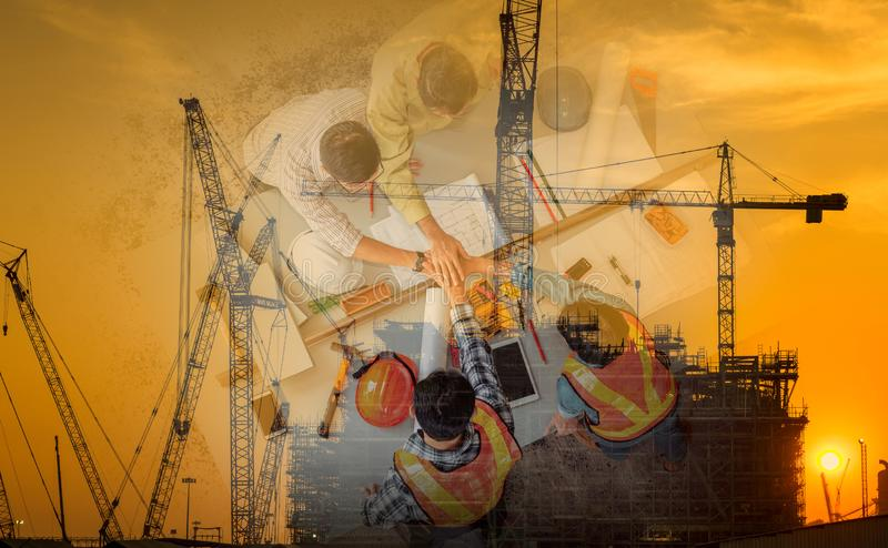 Double Exposure Business Construction Industry and Engineering Concept, Businesspeople are Handshake Together After Deal Project royalty free stock photography