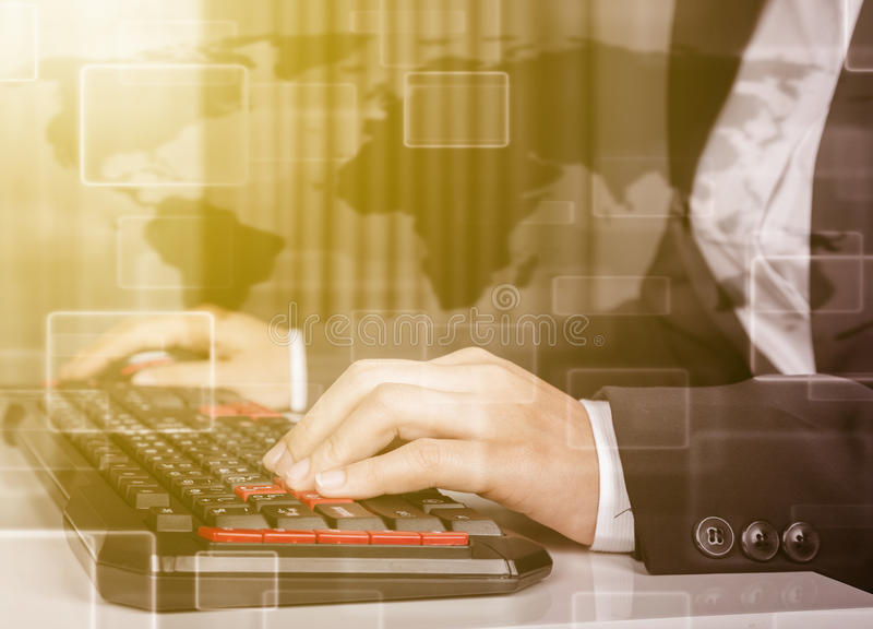Double exposure of business hands working on computer keyboard royalty free stock photo