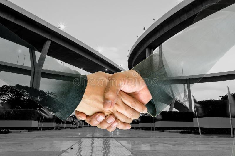 Double exposure of business handshake. stock photo