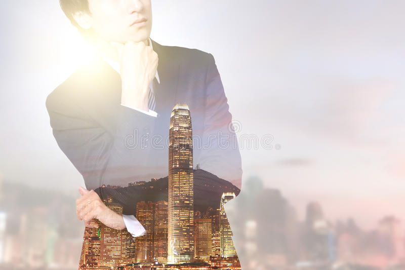 Double exposure business man and city stock images