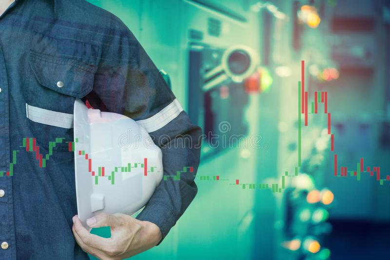 Double exposure of  business man or Engineer holding helmet with industry control room and stock trading chart background for. Investment business concept royalty free stock photos