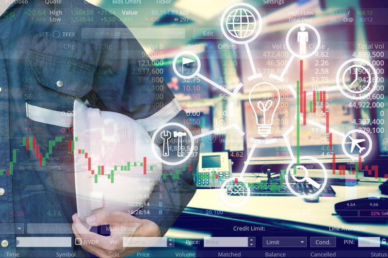 Double exposure of  business man or Engineer holding helmet with stock trading room and stock trading chart background for. Investment business concept royalty free stock photography