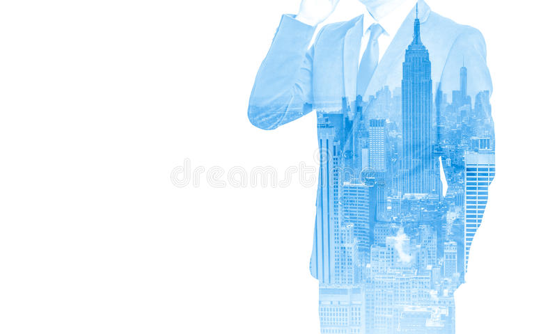 Double exposure of business man with mobile phone and city buildings background. abstract design idea.  royalty free stock images