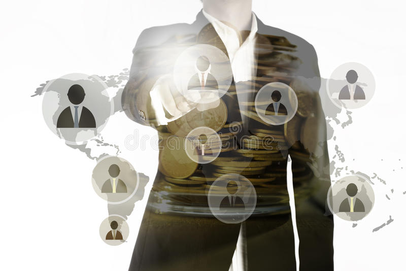 Double exposure of business man point the finger represent leading team and golden coins in jar, leadership concept royalty free stock images