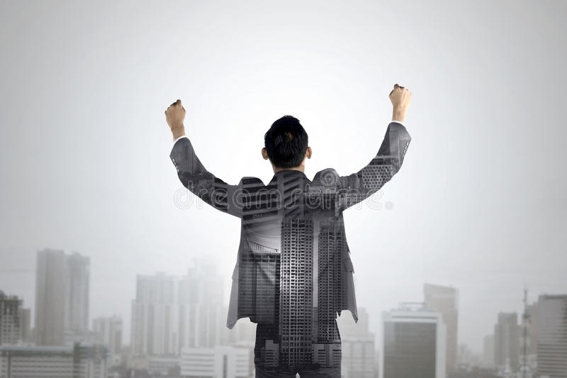 Double exposure of business man raise his hands stock photo