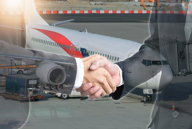 Double exposure of business people handshake with airplane royalty free stock photo