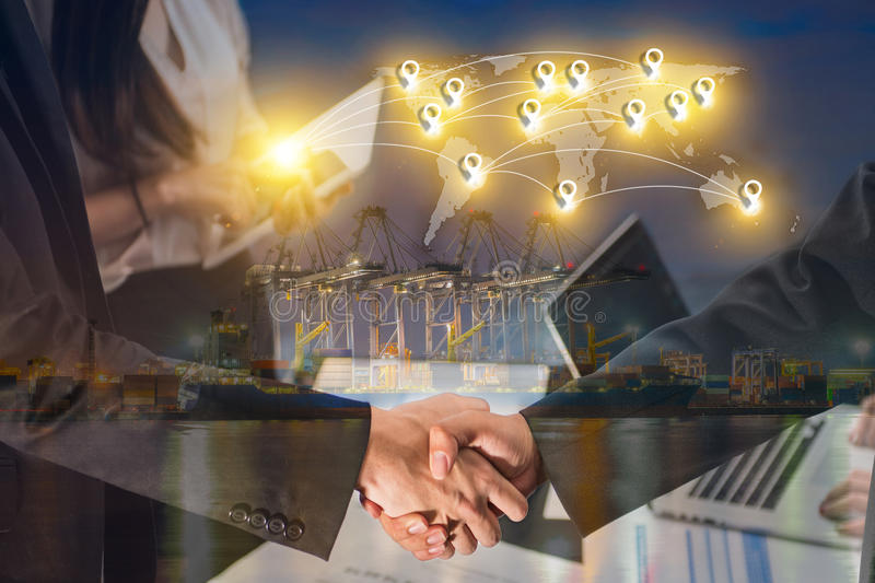 Double exposure of business people handshake greeting deal concept on Industrial port with containers cargo ship background and m. Ap pin flat network conection stock photography