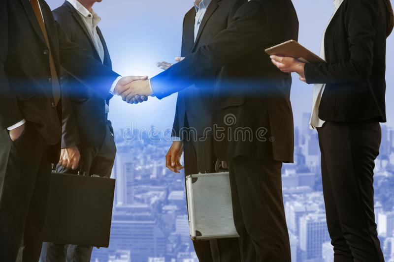 Double exposure Business People Handshake Meeting. Double exposure business people handshake agreement with cityscape in background. Business executive meeting stock images