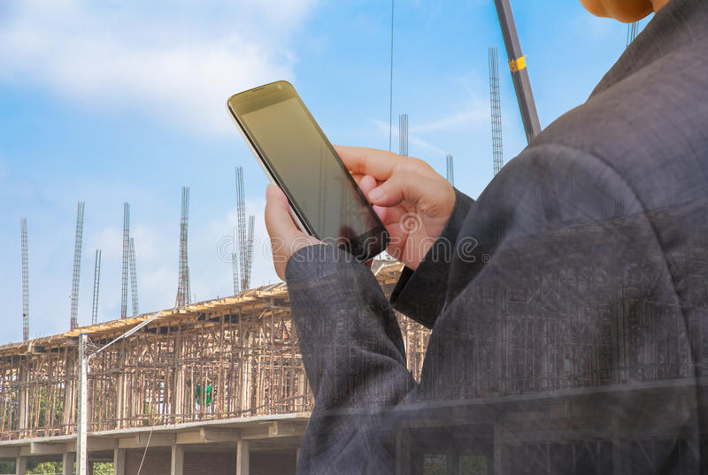 Double exposure Business people with smartphone and book on building background stock image