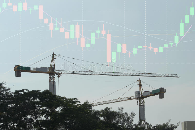Double exposure of business stock chart ,construction crane in b. Ackground royalty free stock photos
