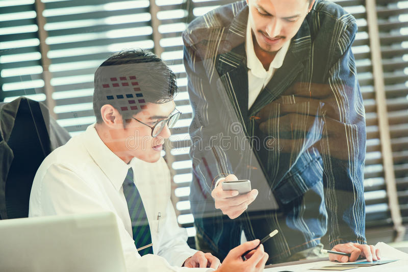Double exposure of of business team discussing ideas and planning project to investment in overseas Branches stock photography
