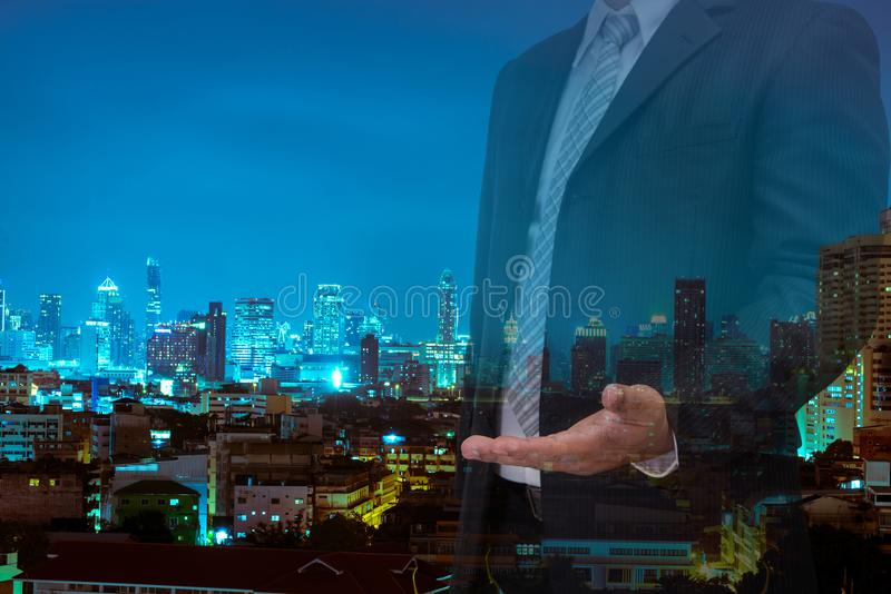 Double exposure of business with welcome hand and night modern c royalty free stock image