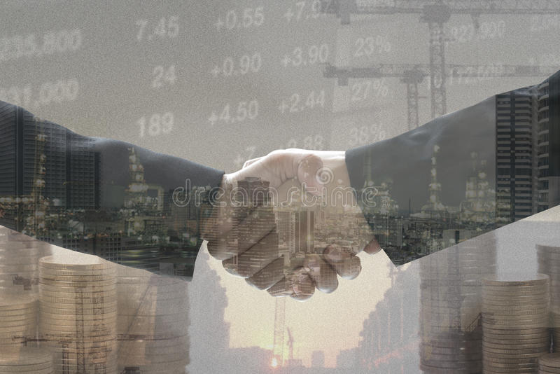 Double exposure business worker with graph finance and factory stock photo