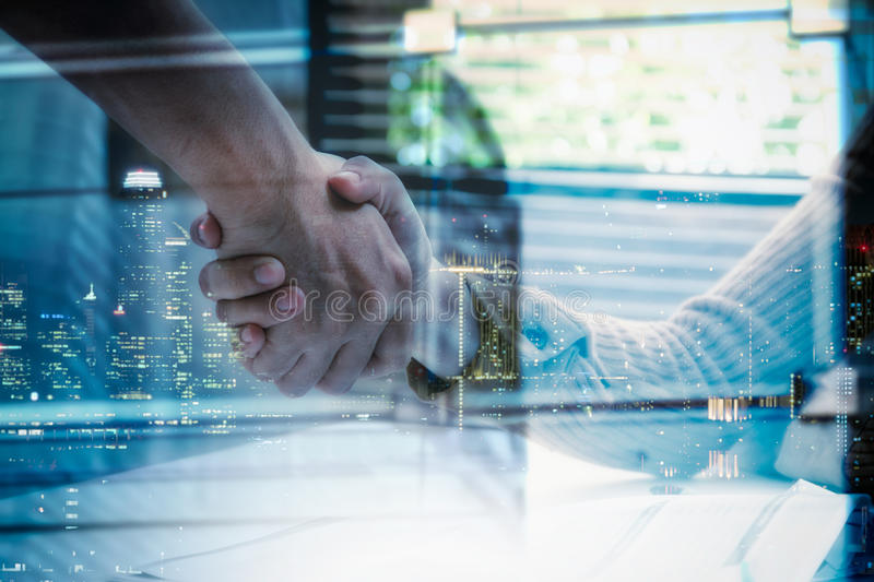 Double exposure of businessman and businesswoman handshake after. Successful on target development project at meeting room, business content anc copy space,mock stock photo