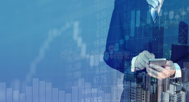 Double exposure of businessman with city background and candle stick and stock market price screen for investor concept royalty free stock image