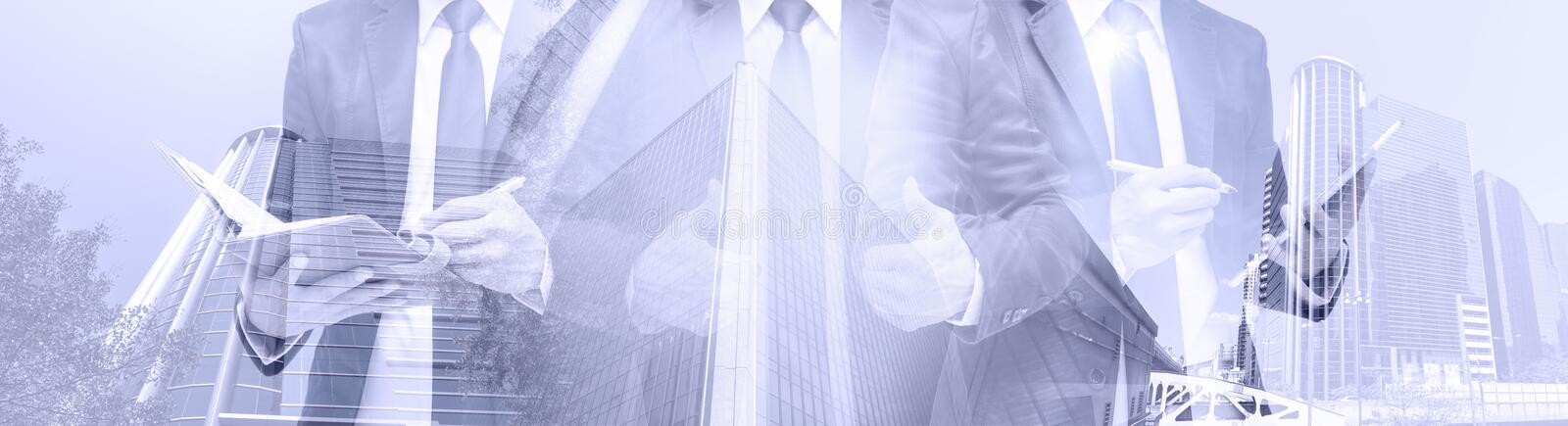 Double exposure of businessman with cityscape, Modern glass Business building stock photos