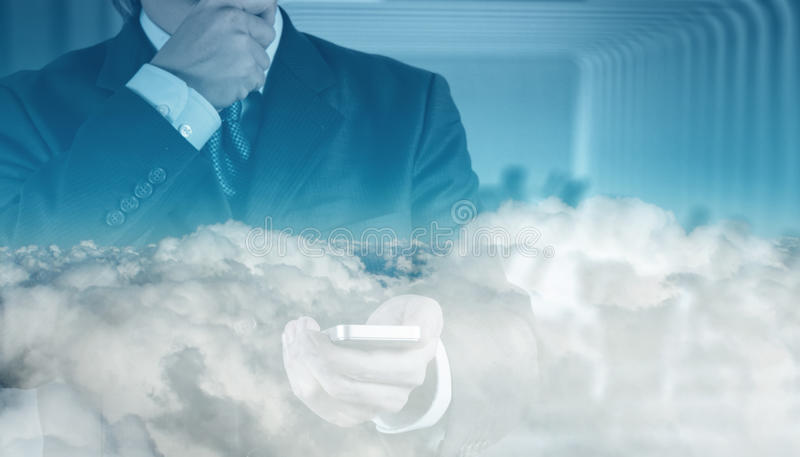 Double exposure of businessman hand. With cloud as concept royalty free stock photo