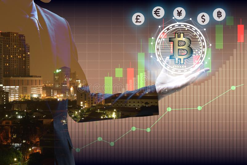Double exposure of businessman Hand holding bitcoin and virtual. Currency with cityscape and stock market or financial graph for financial investment concept royalty free stock photo