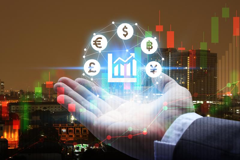 Double exposure of Businessman hand holding interface of Fintech with cityscape and stock market or financial graph for financial stock images