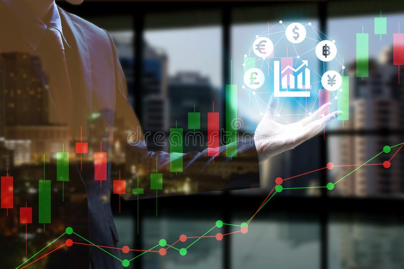 Double exposure of Businessman hand holding interface of Fintech with cityscape and stock market or financial graph for financial. Investment concept royalty free stock photography