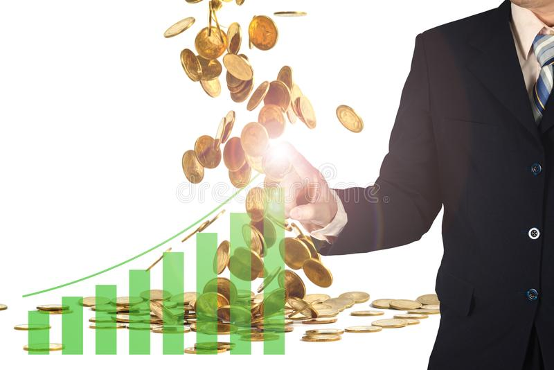Double exposure businessman hand touching virtual panel of growth bar chart on financial graph chart and falling gold coins royalty free stock photos