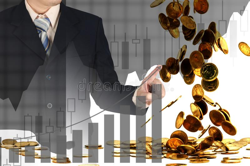 Double exposure businessman hand touching virtual panel of growth bar chart on financial graph chart and falling gold coins royalty free stock image