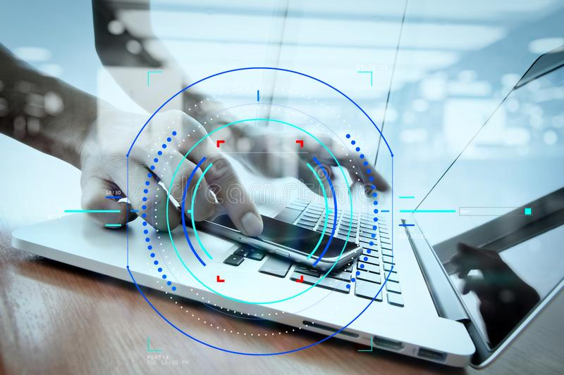 double exposure of businessman hand working with smart phone wit stock images