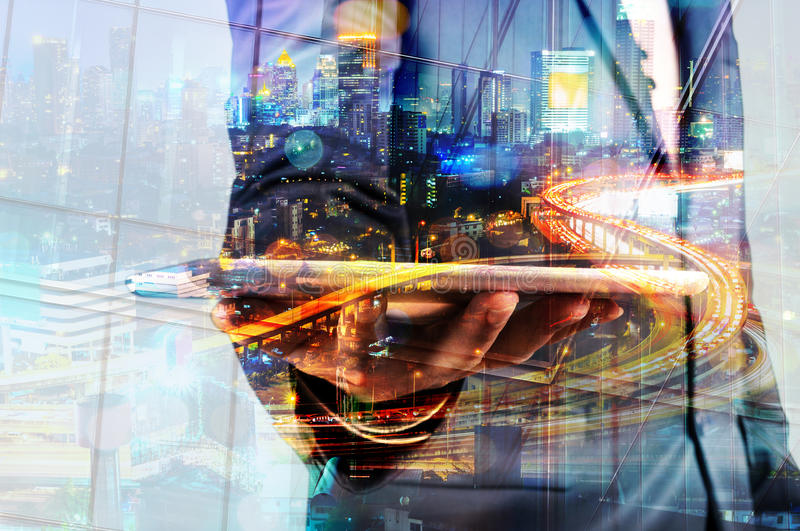 Double Exposure of BusinessMan hold Digital Tablet with Modern C stock images