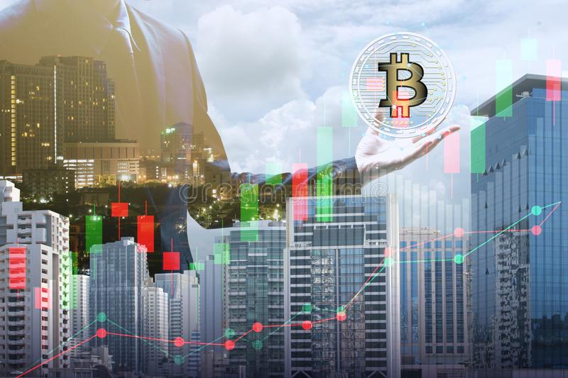 Double exposure of businessman holding the bitcoin and blockchain network connection with cityscape, virtual currency. Blockchain technology concept stock photos