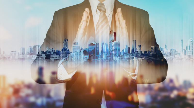 Double exposure businessman holding blue city hologram, real estate business technology. Double exposure businessman holding blue city hologram,real estate royalty free stock images