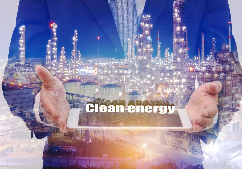 Double exposure businessman holding laptop with text and oil ref stock photos