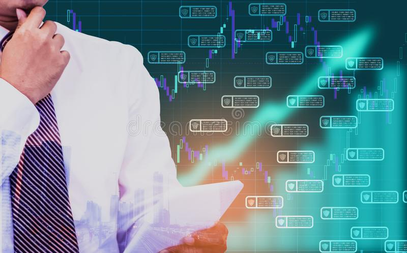 Double exposure - businessman holding a tablet in hand, background is an arrow symbol and a stock chart,Concept of managing and. Storing commercial data for stock photography