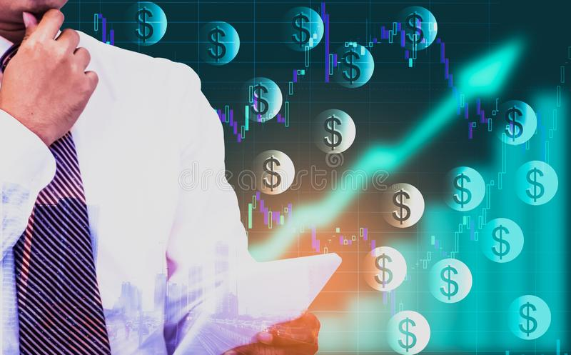 Double exposure - businessman holding a tablet in hand,background an arrow symbol and stock chart,With dollar currency icons,. Concept of currencies growth, and stock photo