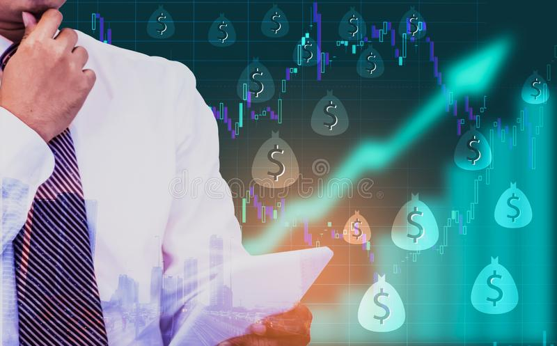 Double exposure - businessman holding a tablet in hand,background an arrow symbol and stock chart,With dollar currency icons,. Concept of currencies growth, and royalty free stock photos