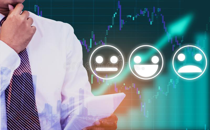 Double exposure - businessman holding a tablet in hand,background an arrow symbol and stock chart,With Emotion icon, Concept of. Management in organization for royalty free stock photo