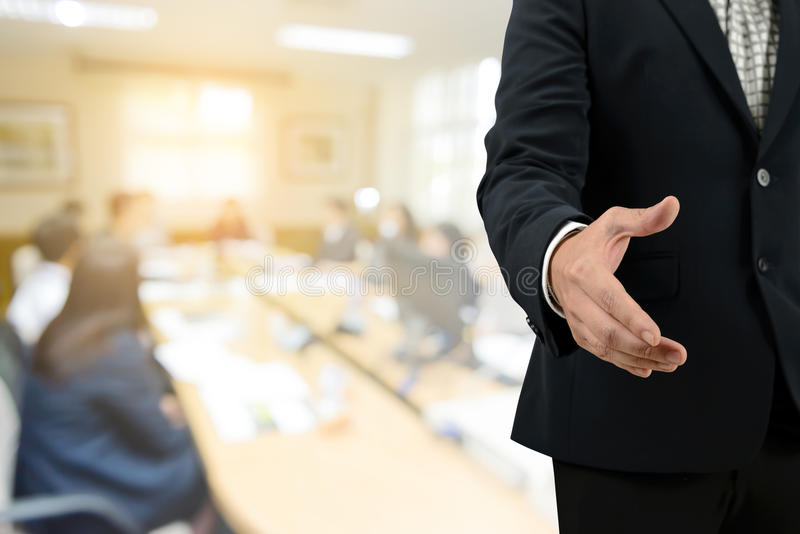 Double exposure businessman open hand for handshake with blurred of business Meeting royalty free stock image