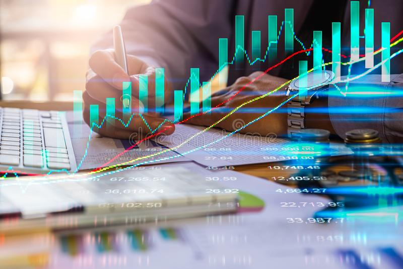 Double exposure businessman and stock market or forex graph suitable for financial investment concept. Economy trends background. For business idea and all art royalty free stock image