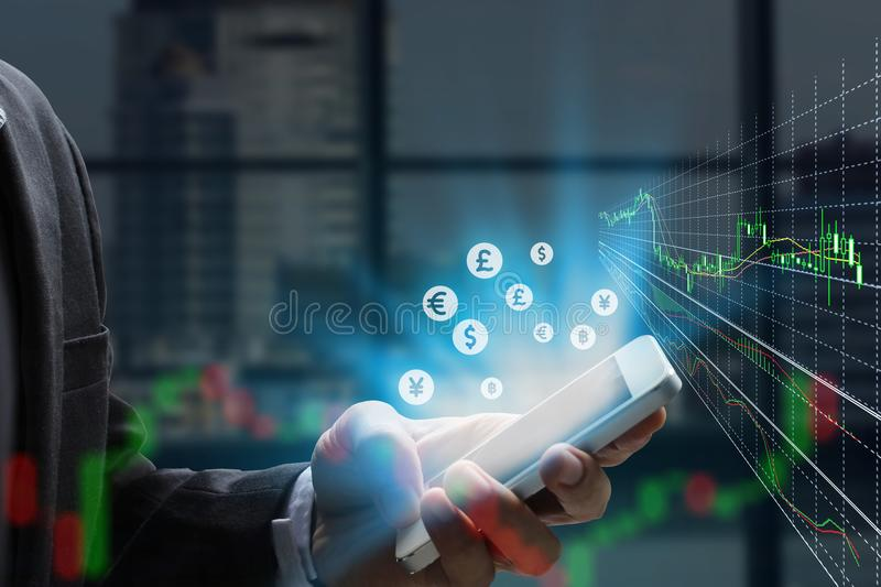 Double exposure businessman using the smart phone and stock mark stock photo