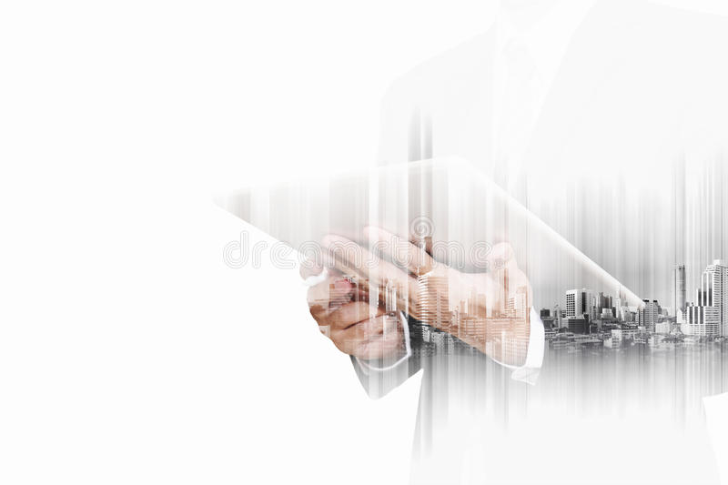 Double exposure businessman working on digital tablet, with blue city technology background, isolated on white background royalty free stock images