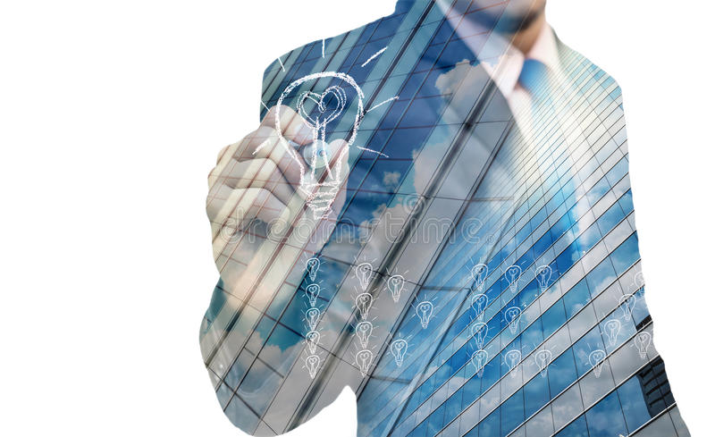 Double exposure of businessman writing the idea with cityscape building glass royalty free stock photos
