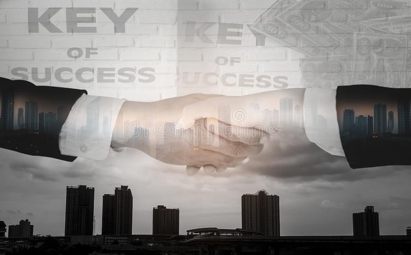 Double exposure-Businessmen shake hands,accept business cooperation agreements for partnership and investment,brick wall and city. Landscape background,concept stock illustration