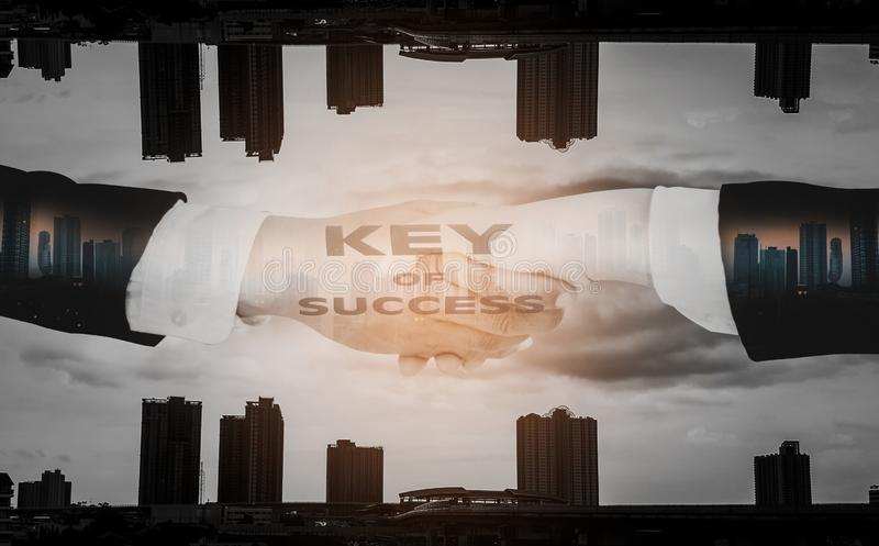 Double exposure-Businessmen shake hands,accept business cooperation agreements for partnership and investment,city landscape. Background with concept key of stock illustration