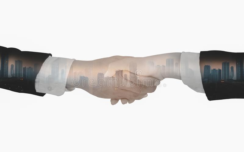 Double exposure-Businessmen shake hands,accept business cooperation agreements for partnership and investment,white isolated. Background,concept key of success stock image
