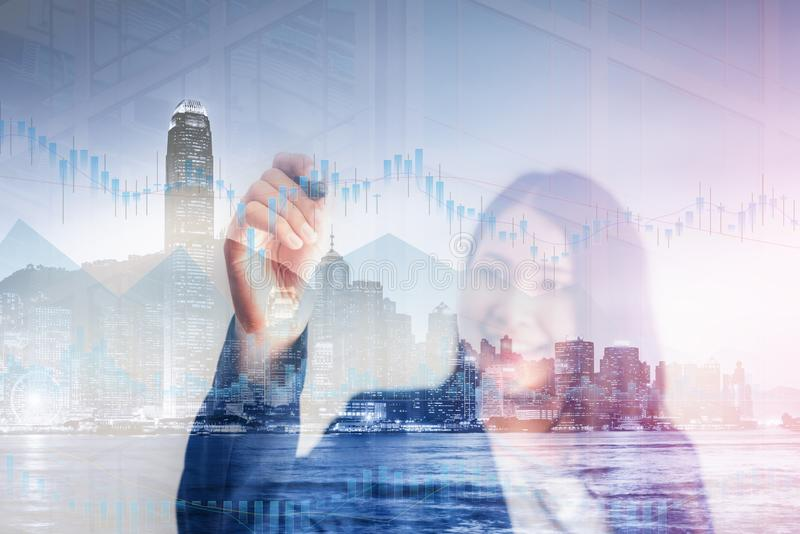 Double Exposure of Businesswoman is Tracking Stock Chart Info On The Screen, Business Financial Analyzing Investment and Stock. Market Concept. Stock Exchange royalty free stock image