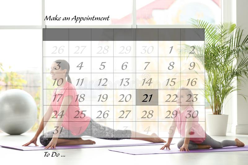 Double exposure of calendar and family doing yoga together stock photography